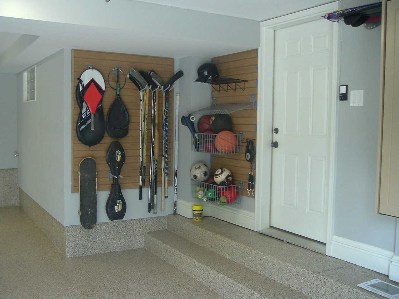Use SlatWall Panels & SlatWall Accessories to Organize kids' toys and sports equipment