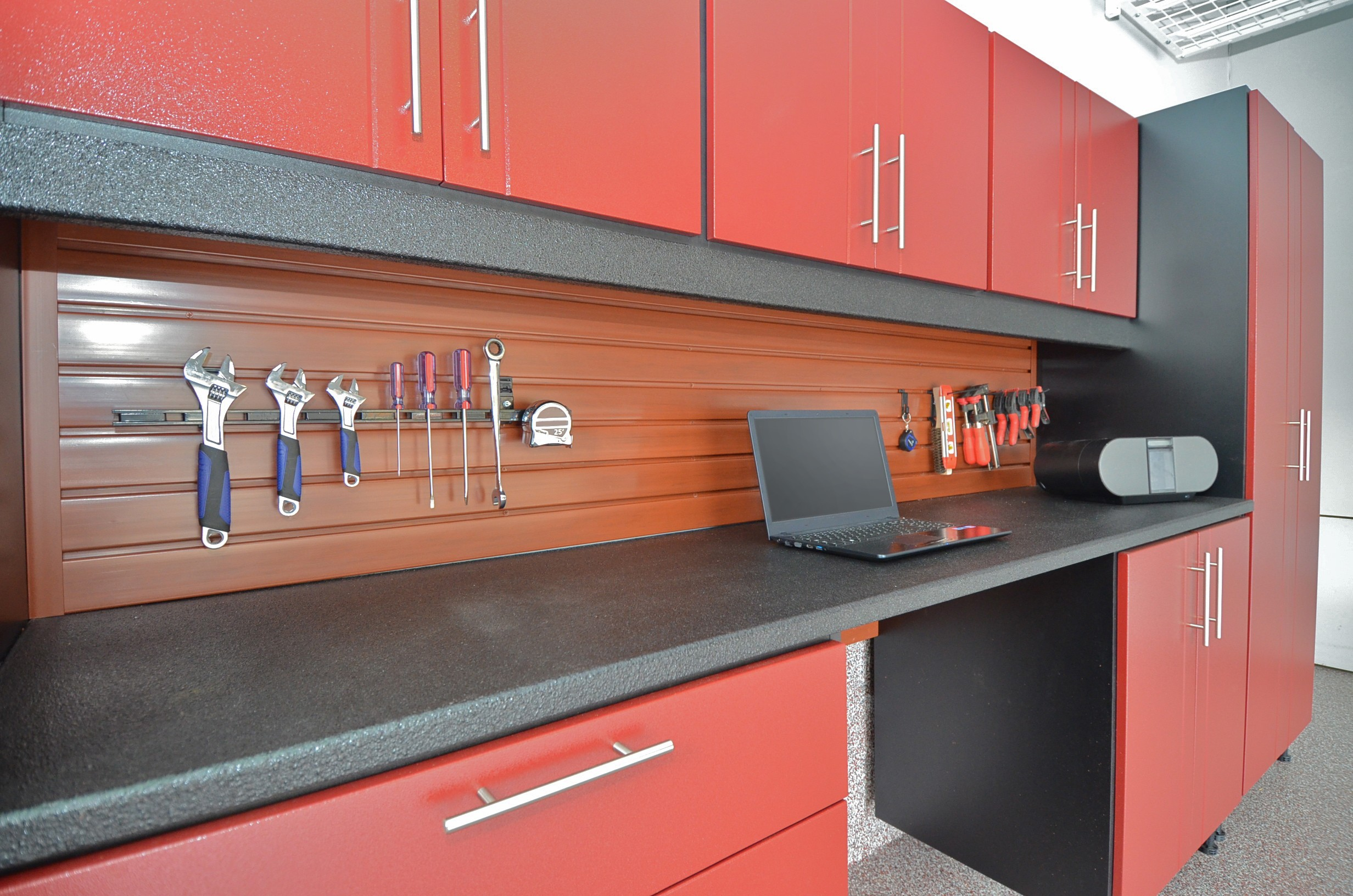 SlatWall Panels & SlatWall Accessories Above A WorkSpace Garage Cabinets Workbench Area