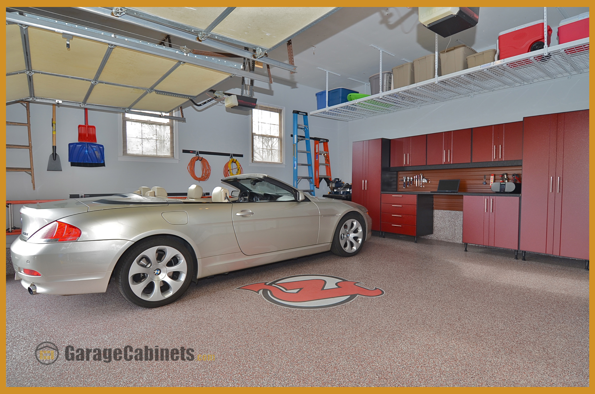 A Sports Fan's Garage Organized With WorkSpace Garage Cabinets