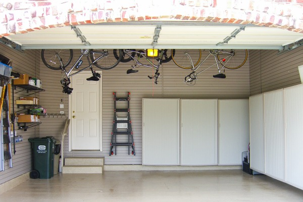 Additional storage created by adding slatwall panels to garage walls.